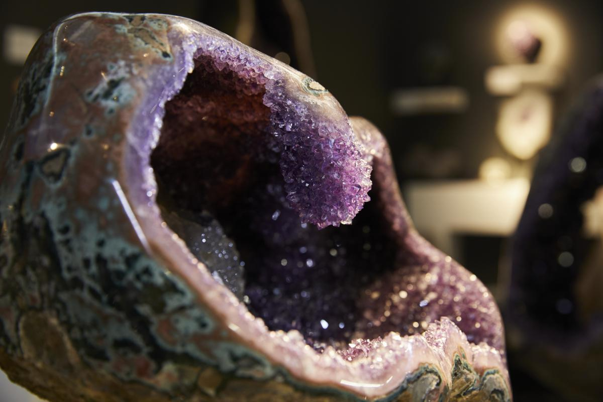 HALF AMETHYST GEODE WITH UNSUSUAL MINERAL AND CRYSTAL