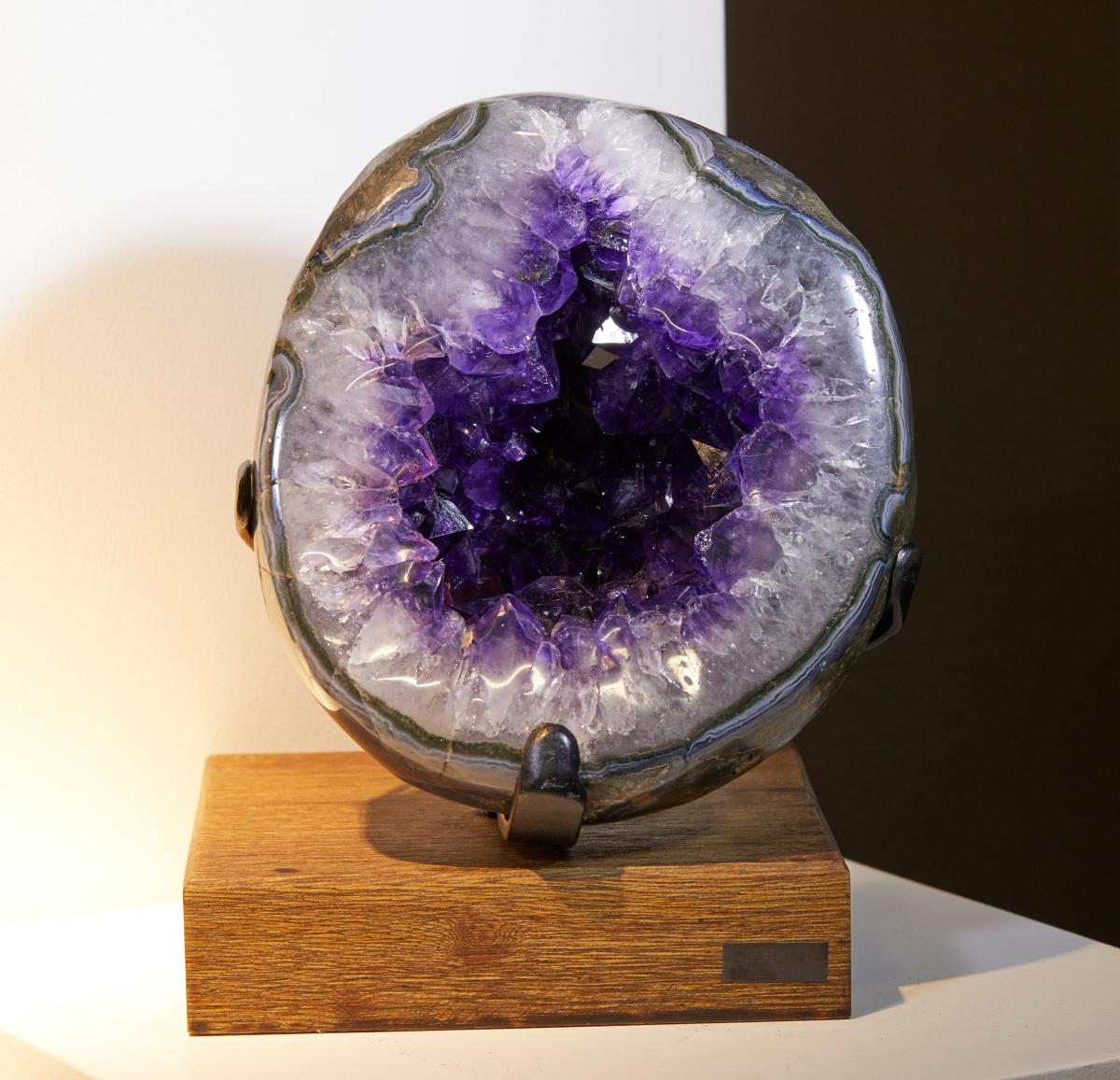 POLISHED SPLIT AMETHYST GEODE  SURROUNDED BY WHITE QUARTZ