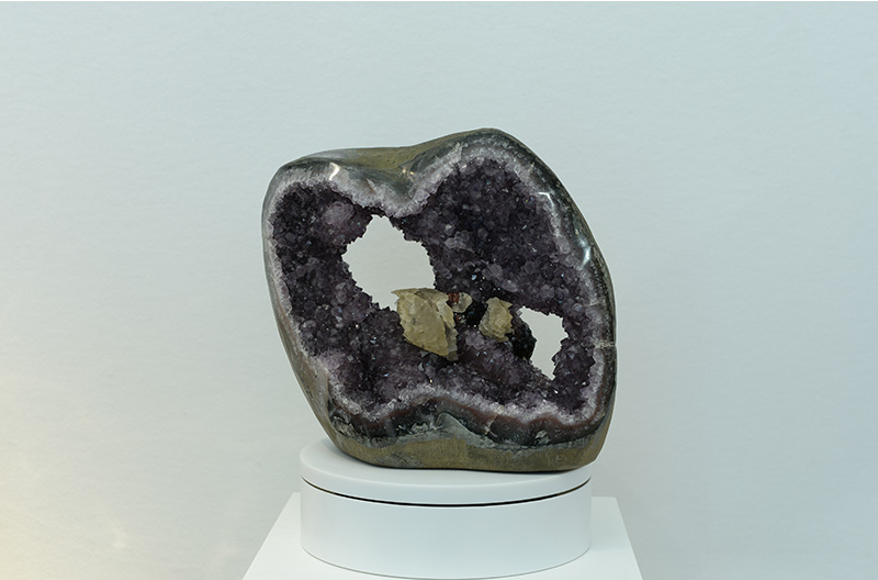 SMALL amethyst GEODE with several crystal FORMATIONS inside