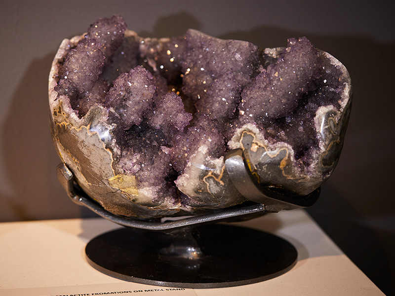 STUNNING PURPLE STALACTITE FROMATIONS ON METAL STAND
